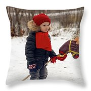 Boy On A Toy Horse Is Standing On The Street In Winter Throw Pillow