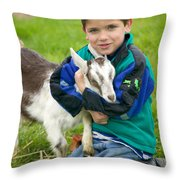Boy With Goat Throw Pillow