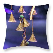 Brass Bells Hanging In The Illuminated Courtyard At Winter Night Throw Pillow