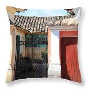 Brick House With Iron Gate Throw Pillow