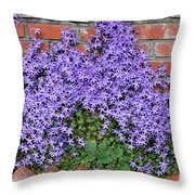 Brick Wall With Blue Flowers Throw Pillow