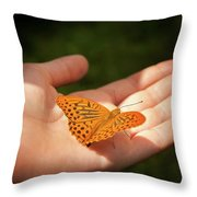 Butterfly On A Childs Hand Throw Pillow