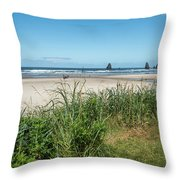 Cannon Beach And Purple Bloom Throw Pillow
