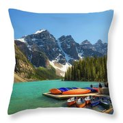 Canoes On A Jetty At  Moraine Lake In Banff National Park, Canada Throw Pillow