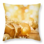 Christmas Scene With Gold Baubles And Gift On A Gold Background Throw Pillow