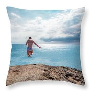Cliff Jumping Throw Pillow by Break The Silhouette