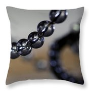 Close-up View Of A String Of Beads Throw Pillow