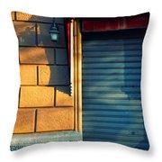 Closed Shop Door At Sunset Throw Pillow by Silvia Ganora
