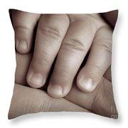 Closeup Of A Baby's Hand Throw Pillow