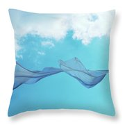 Cloth In The Wind Against The Blue Cloudy Sky. Throw Pillow