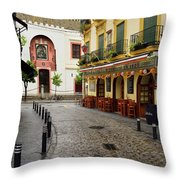 Cobblestone Argote De Molina Street With Cafe Ending At The Nort Throw Pillow