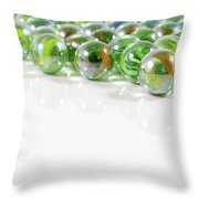 Composition With Green Marbles On White Background Throw Pillow