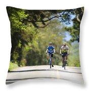 Couple Enjoying A Back Road Bike Ride Throw Pillow