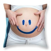 Couple Painting A Smiley On A Pregnant Woman's Belly Throw Pillow