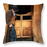 Cowboy By Saloon Doors Throw Pillow