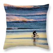 Cyclist Pedals Against The Wind At Pismo Beach Throw Pillow