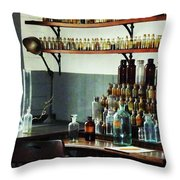 Desk With Bottles Of Chemicals Throw Pillow