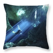 Diver Silhouetted In Sunrays Of Cenote Throw Pillow