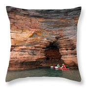Exploring The Sea Caves Throw Pillow