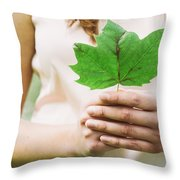 Female Hands Holding Leaf Throw Pillow