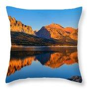 First Light Across Lake Sherburne Throw Pillow by Greg Norrell