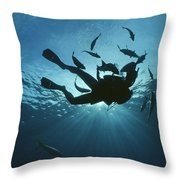 Fish Swim Around A Diver In The Cayman Throw Pillow