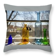 Five Colored Bottles Throw Pillow