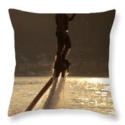 Flyboarder And Water Droplets Backlit At Sunset Throw Pillow
