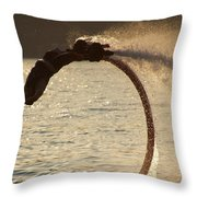 Flyboarder Doing Back Flip Over Backlit Waves Throw Pillow