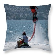 Flyboarder In Pink Shorts Above Jet Ski Throw Pillow