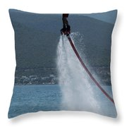 Flyboarder In Silhouette Balancing High Above Water Throw Pillow