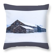 Four Barns In A Snowstorm Throw Pillow