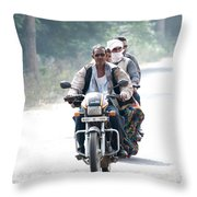 Four People On A Motorbike Throw Pillow