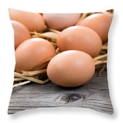 Fresh Organic Eggs On Rustic Wooden Boards And Straw Throw Pillow