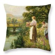 Gathering Spring Flowers Throw Pillow