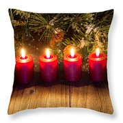 Glowing Red Candles With Snow Covered Evergreen Branch On Rustic Throw Pillow