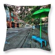 Green Umbrella Bus Stop Throw Pillow by Michael Thomas