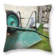 Green Wheelbarrow Lying On A Green Meadow Throw Pillow