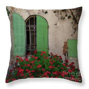 Green Windows And Red Geranium Flowers Throw Pillow by Yair Karelic