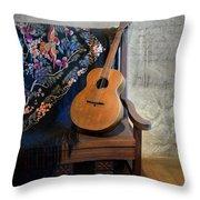 Guitar On A Bench Throw Pillow