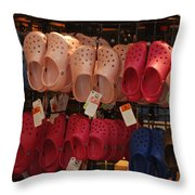 Hanging Crocs Throw Pillow by Rob Hans