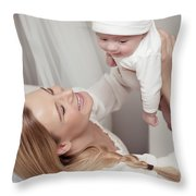 Happy Mother With Her Baby Throw Pillow