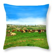 Herd Of Cows Under A Blue Sky In Green Hills Throw Pillow