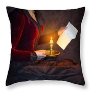 Historical Victorian Woman Reading A Letter By Candlelight Throw Pillow