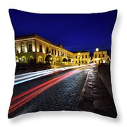 Indigo Sky And Car Lights Over Plaza Espana And Puente Nuevo Bri Throw Pillow