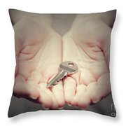 Key In Woman's Hand In Gesture Of Giving. Concept Of Success In Live, Business Solution, Real Estate Etc Throw Pillow