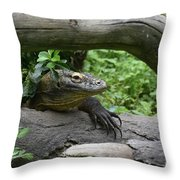 Komodo Dragon Creeping Through Two Fallen Logs Throw Pillow
