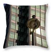 Lamp Post Against Green Glass Building Throw Pillow