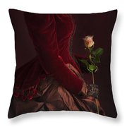 Late Victorian Woman In A Crimson Velvet Jacket And Dress Holdin Throw Pillow