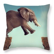 Leap Of Faith Concept Elephant Jumping Across A Crevasse Throw Pillow